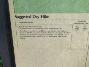 """Our first hike of the day: the South River Falls Circuit. The sign indicates that this is a """"moderately easy"""" hike. Note: the sign is lying, unless you are the sort of person who considers climbing a mountain """"easy."""""""