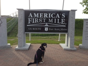 ...and here she is standing at the Maine end of U.S. 1., 2,369 miles away.