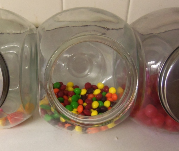 The other day, I bought some Skittles. Here they are, looking festive in one of my candy jars. I did not suspect that those green Skittles harbored a terrible, terrible secret: they were not lime, but green apple flavored.